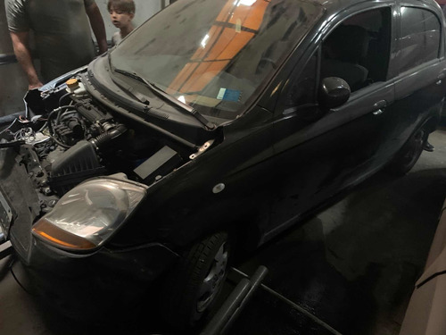 chevrolet spark chocado baja dividid con alta motor (04)