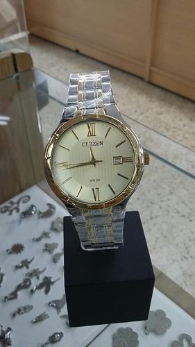 clásico reloj citizen combinado con dorado 50mts
