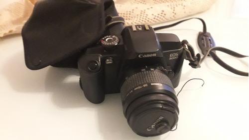 câmera canon eos 5000 (filme), lente canon 38-76mm e case