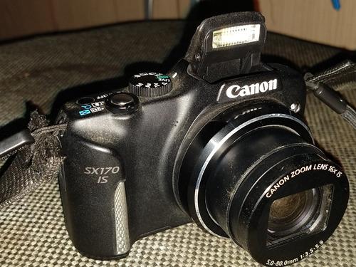 cãmera marca canon,semi nova pouco usada !!!