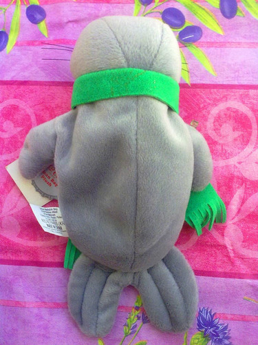 coca cola peluche de foca con bufanda