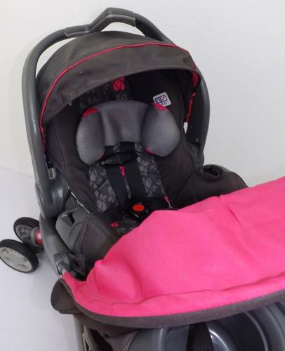 coche y porta bebe para niña con base para vehículo evenflo