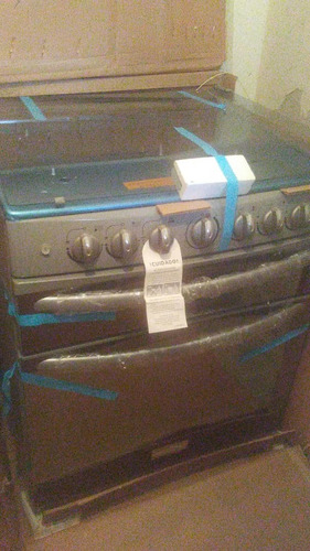 cocina a gas marca mabe 5 hornillas/doble horno. acero inox.