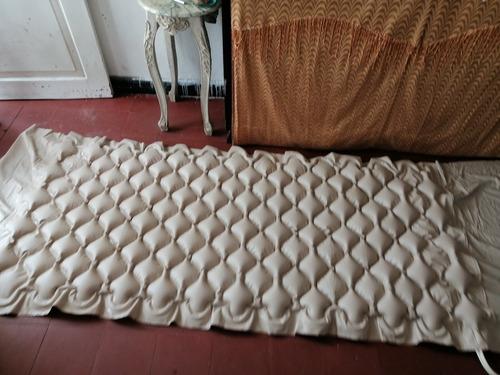 colchón inflable antiescara + paca de paño