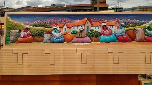colgador tallado en madera cedro