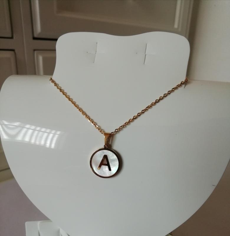 58a402680bff collar dije letra inicial acero inoxidable y madre perla. Cargando zoom.