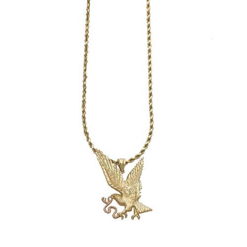 collar oro amarillo con dije motivo águila devorando serpien
