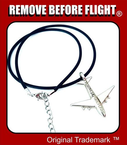 collar unisex  caucho & dije de avión -remove before flight