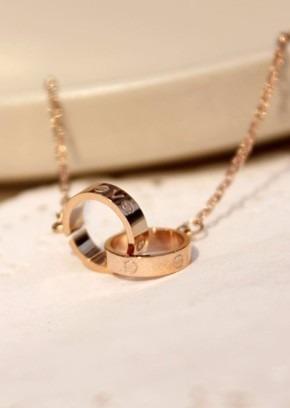 collar unisex moda titanium aros entrecruzados oro rosa