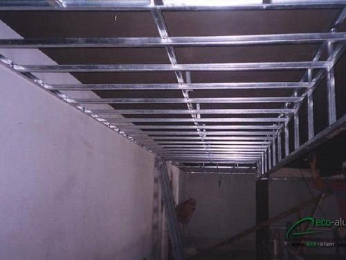 colocación  de durlock, zócalos y pisos flotantes