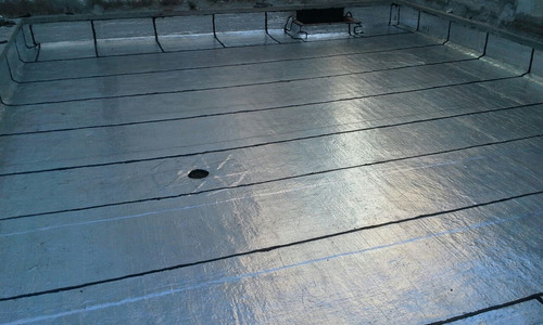 colocación de membrana asfaltica de 4mm construcción general