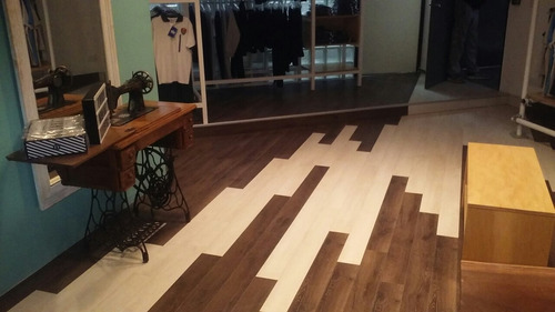 colocacion de pisos flotante con zocalos, manta  $70 m2