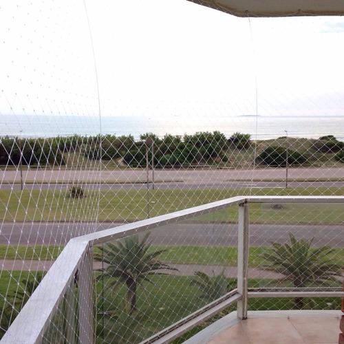 colocacion de redes de protección de balcones, ventanas