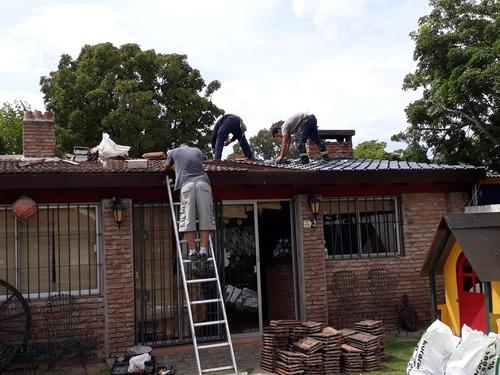 colocacion  de tejas y reparaciones de techos