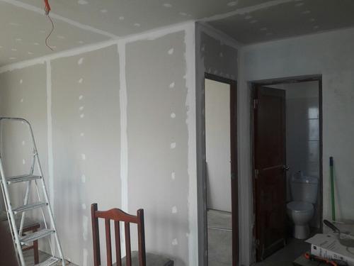 colocación de yeso. cielorrasos y revestimiento de paredes