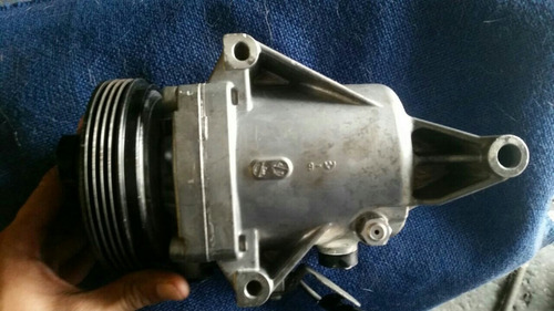 compresor aire acondicionado nissan tida y versa