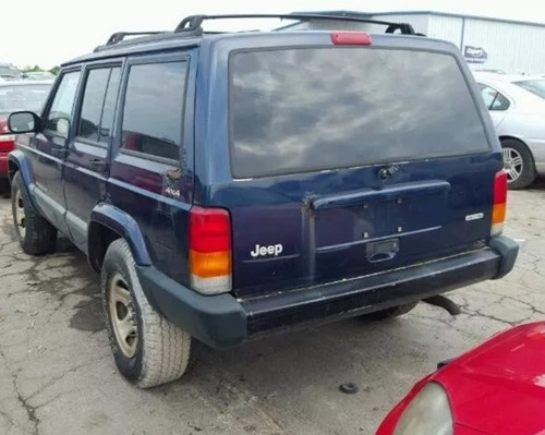 compuerta trasera con medallon jeep cherokee sport 1997