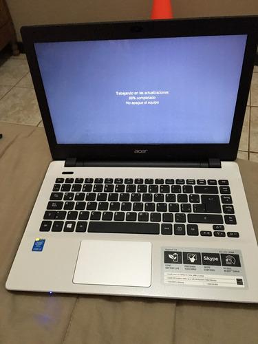 computadora acer aspire e14 de color blanco.