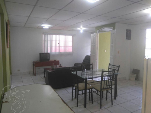 condominio de 6 apartamentos + 1 casa