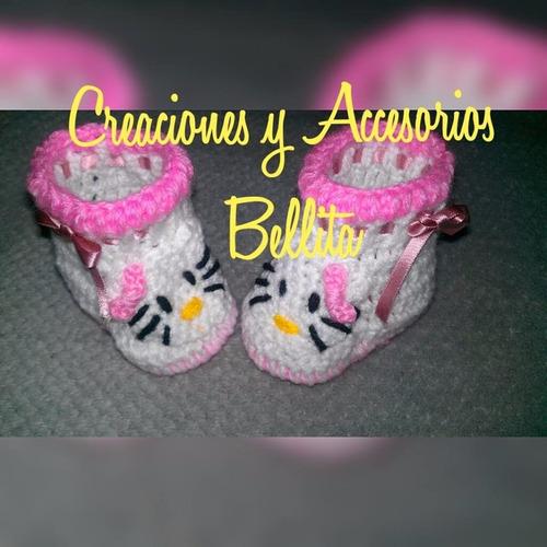 conjunto de botas y diadema en crochet para niña