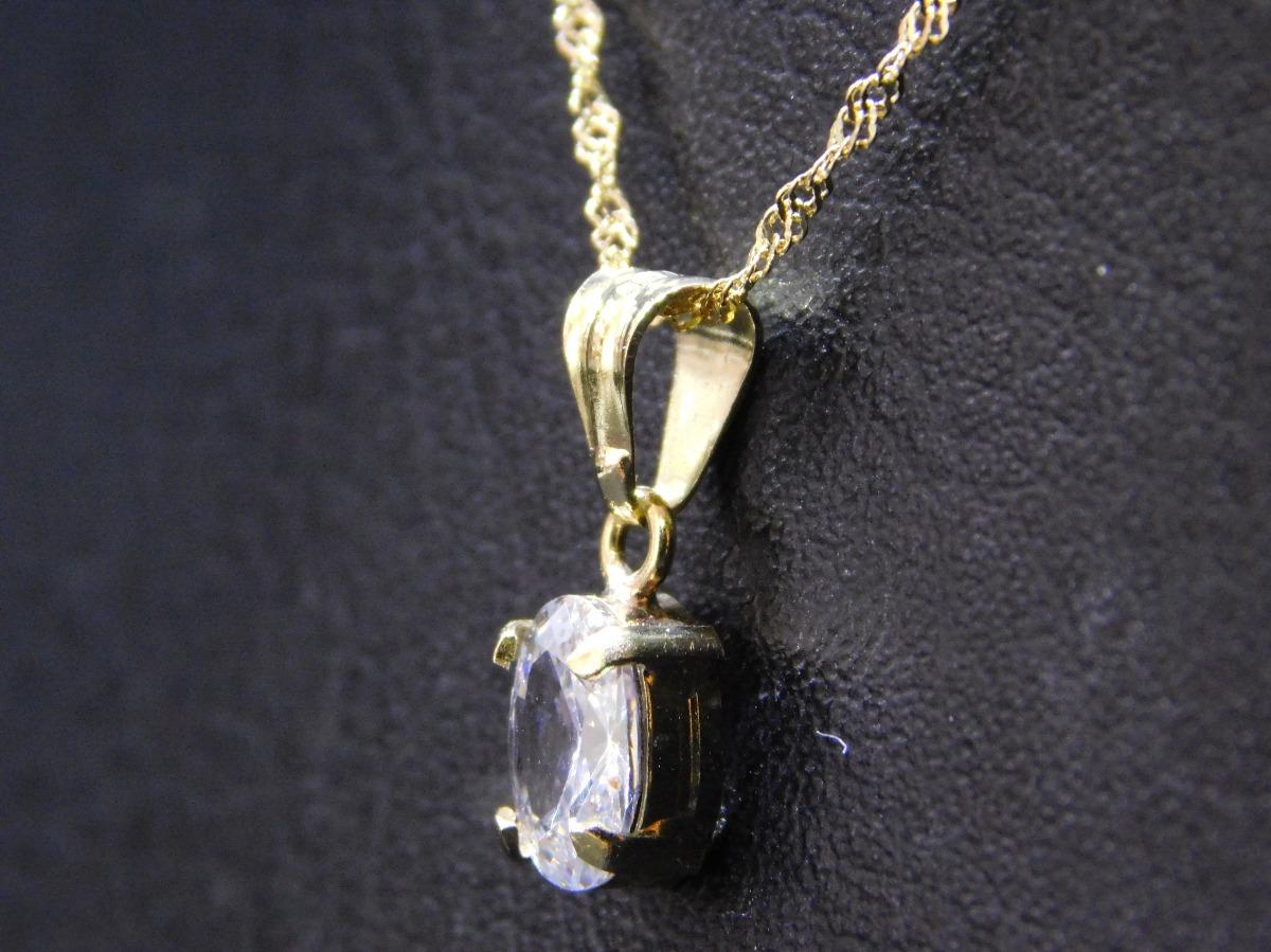 2b2bb9d2ab16 conjunto oro 18 kilates susano colgante con grifas y cadena. Cargando zoom.