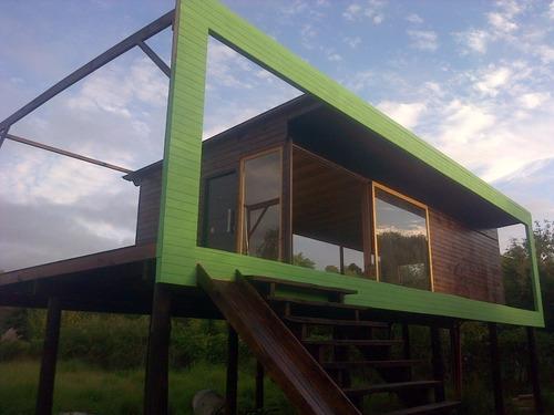 construcción de cabañas de madera, decks, pergolas y más.
