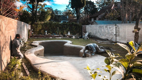 construcción de piscinas de arena tratada