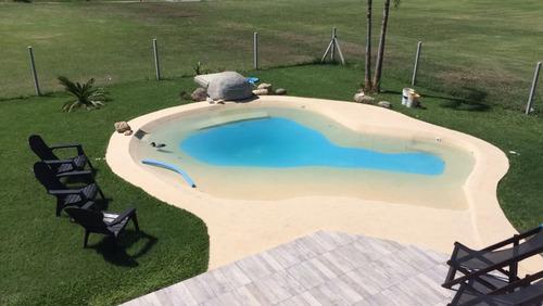 construcción de piscinas playas arena
