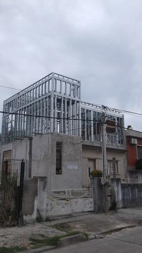 construcciones: casas tradicional o steel framing
