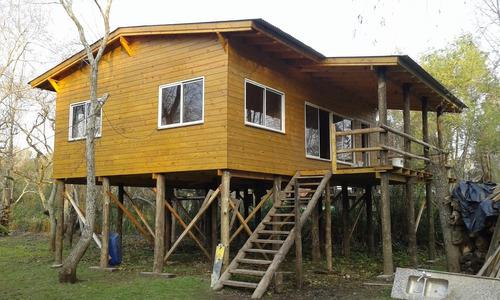 construcciones de cabañas y casas de madera