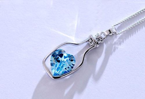 correntinha banhado a prata, pingente azul coração deriva.