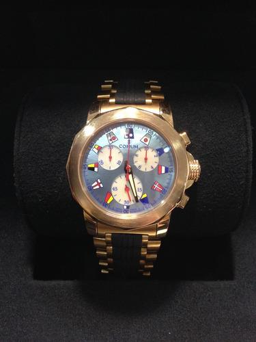corum oro rosa de 18 k cronografo, caratula madre perla.