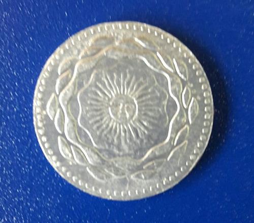 cospel del interior de la moneda de dos pesos