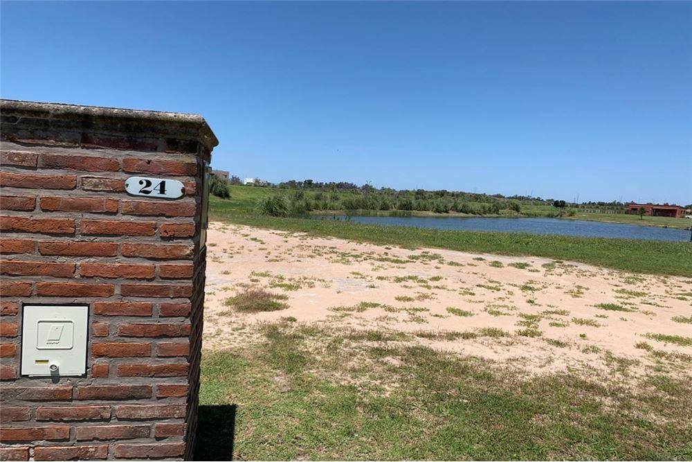country el cantón,b° puerto lote 24. no perimetral