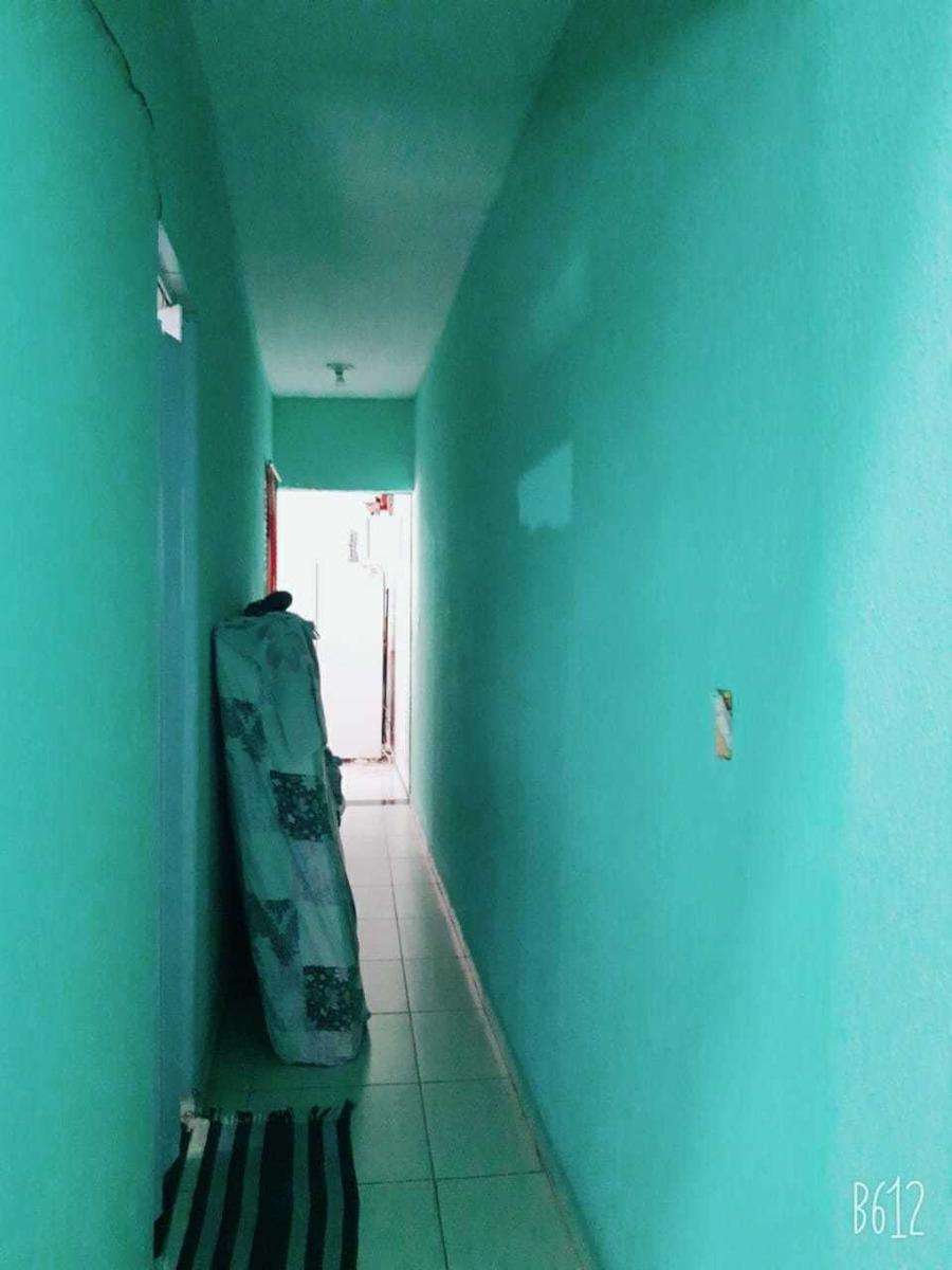 cozinha, sala, 1 quarto ,lavanderia, garagem pra 2 carros