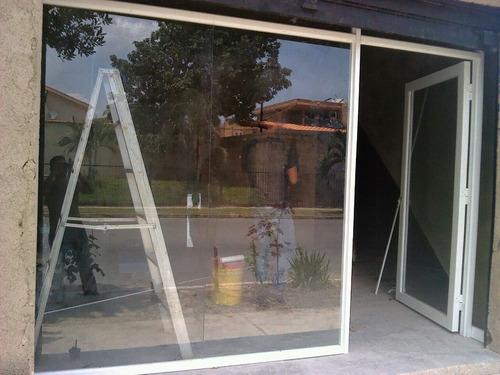 cristalería  fachadas y cerramientos en vidrios glassminium