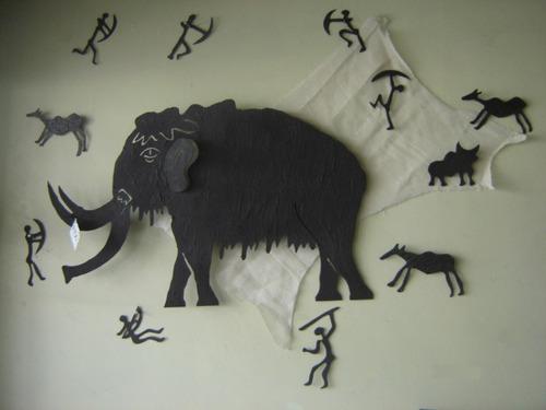 cuadro artistico en metal piezas sueltas mamut con cazadores