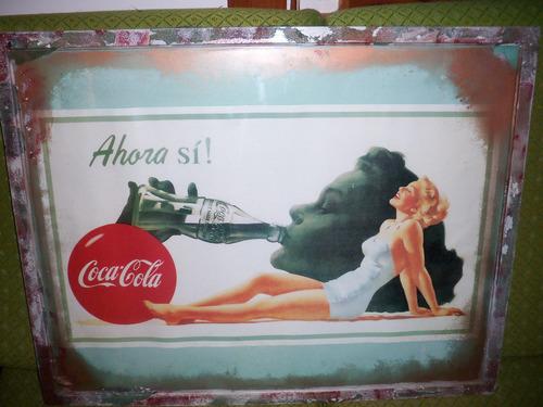 cuadro con propaganda de coca cola