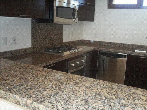 Cubiertas de granito natural marmol y cocinas 2 550 for Precio granito gris
