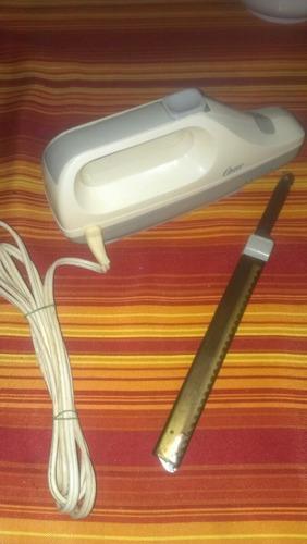 cuchillo eléctrico marca oster