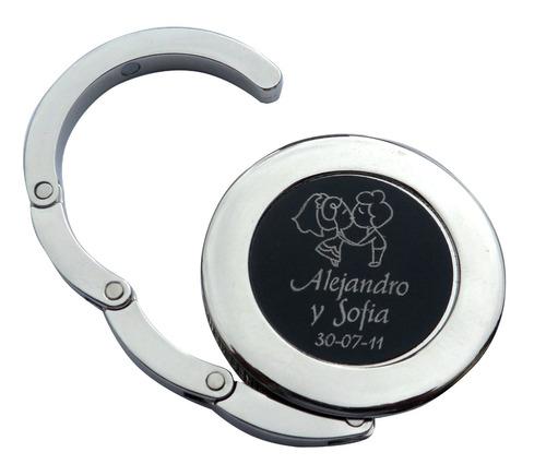 cuelga bolsos metálico personalizados  grabado permanente