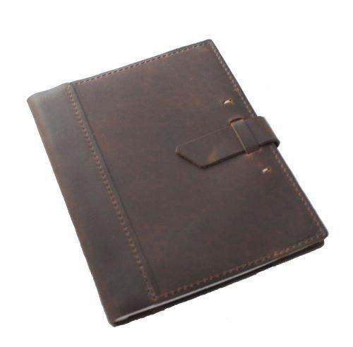 cuero de la cubierta cuaderno de la composición con el cole