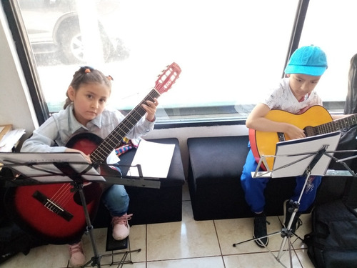 cursos de guitarra, piano, pintura y dibujo