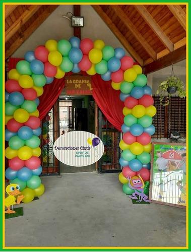 decoración con globos, ambientación con telas y mesas candy