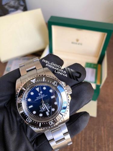 deepsea prata degrade preto e azul com caixa e documentos