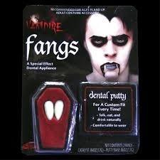 dente de vampiro  realista - ótimo produto -resina importada