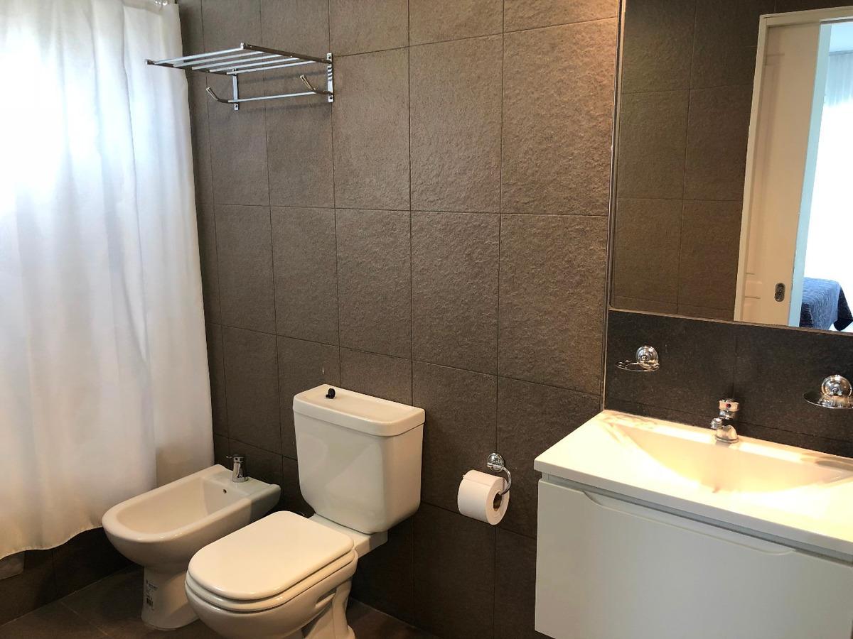 departamento céntrico, 3 ambientes, 2 baños, parrilla, garag