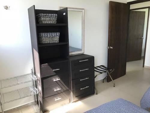 departamento en renta o venta  en isola cancun de 3 recámaras sin muebles