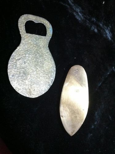 destapador y cenicero de bronce