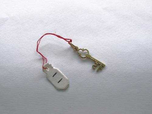 dije figura llave con numero 15 oro 18k 1.1 gramos id-5632